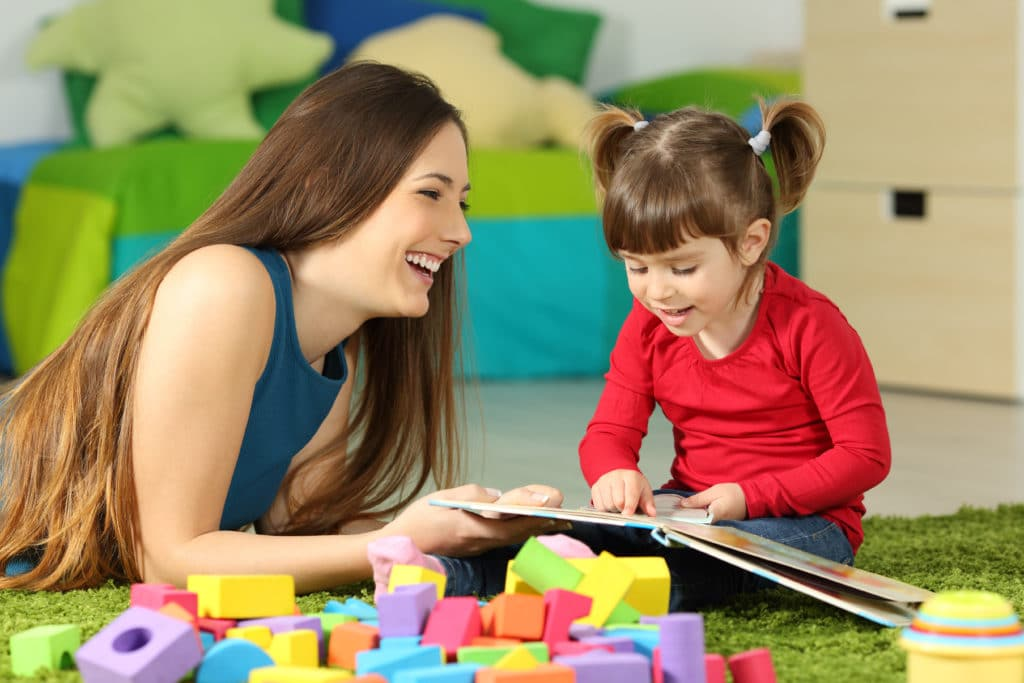 a mother playing with a child with developmental delay issues