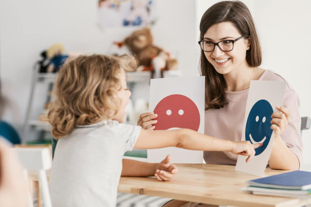 a therapist working with an autistic child