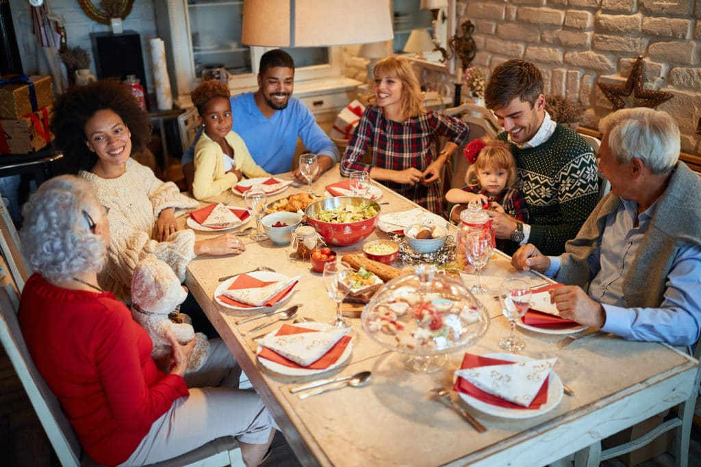 Happy Family and friends at Christmas dinner.Christmas eve with traditional food.