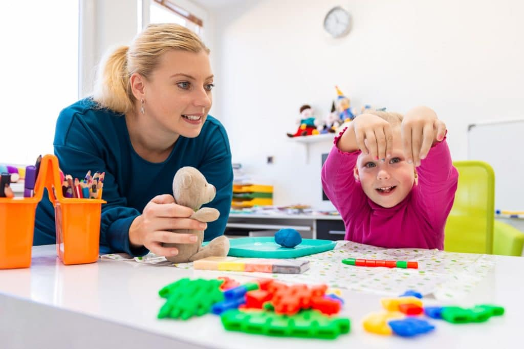 parent and child with ADHDenjoying table activities